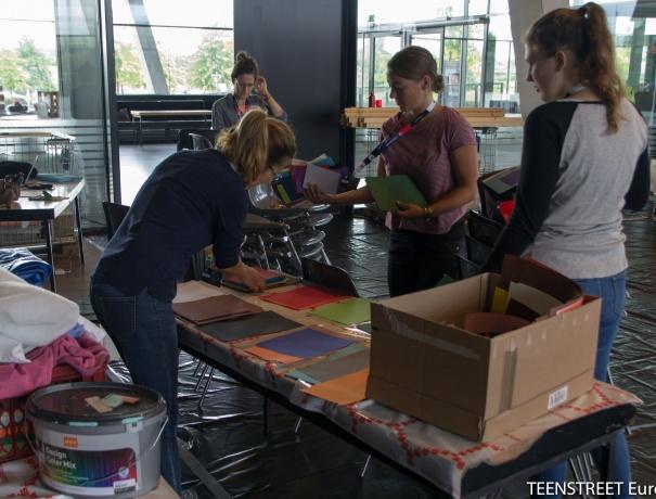 Service team members prepare the TeenStreet site during set-up week.